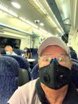 Mad masked man on train